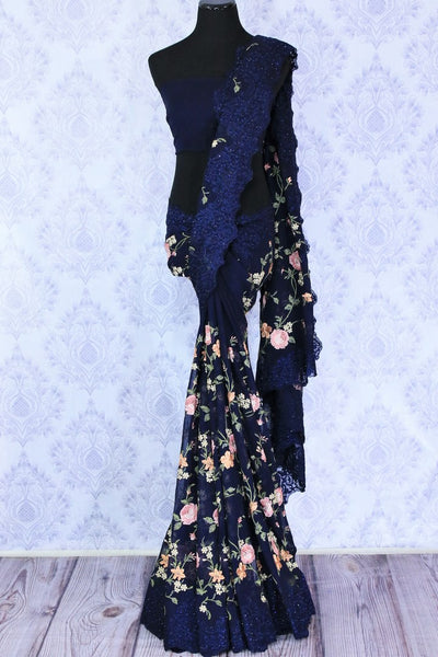 Buy navy blue floral embroidery georgette designer sari online in USA. Dazzle in this gorgeous sari with floral embroidery at parties and special occasions. Make your party look special with beautiful Indian designer saris available at Pure Elegance Indian clothing store in USA or shop online.-full view