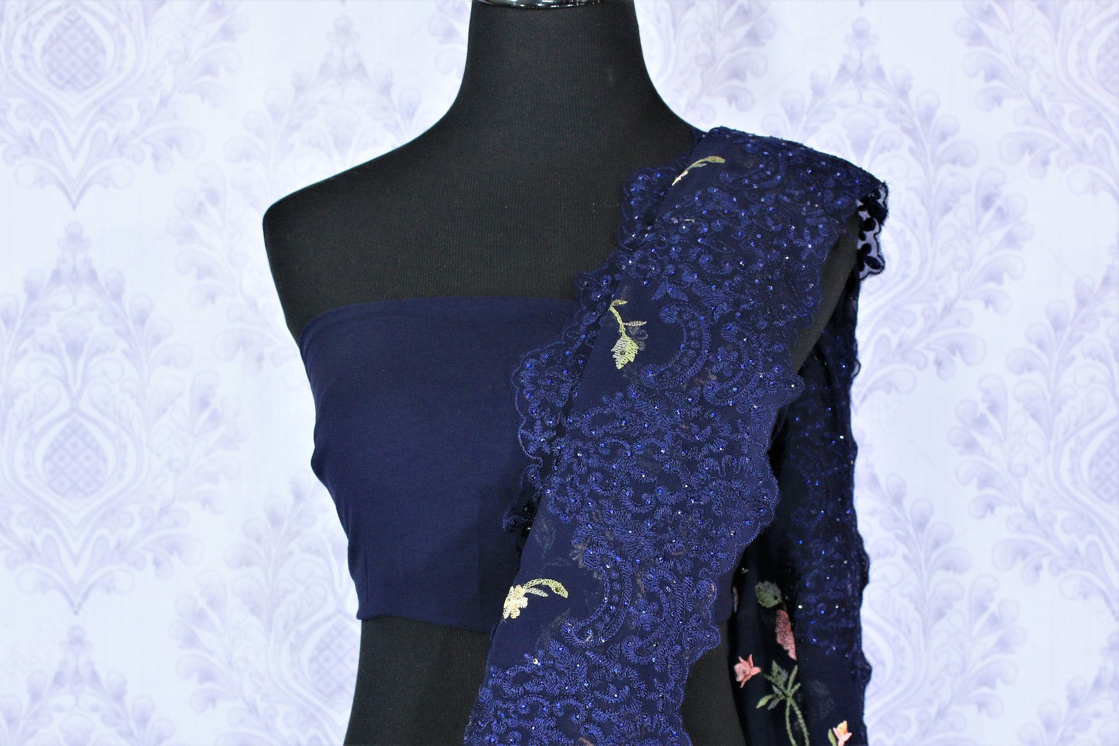 Buy navy blue floral embroidery georgette designer sari online in USA. Dazzle in this gorgeous sari with floral embroidery at parties and special occasions. Make your party look special with beautiful Indian designer saris available at Pure Elegance Indian clothing store in USA or shop online.-blouse pallu