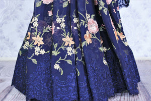 Buy navy blue floral embroidery georgette designer sari online in USA. Dazzle in this gorgeous sari with floral embroidery at parties and special occasions. Make your party look special with beautiful Indian designer saris available at Pure Elegance Indian clothing store in USA or shop online.-pleats