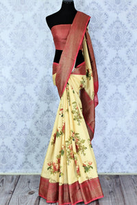 Buy cream floral print tussar silk saree with Banarasi border online in USA. Make your Indian look special with beautiful Indian Banarasi sarees available at Pure Elegance Indian clothing store in USA or shop online.-full view