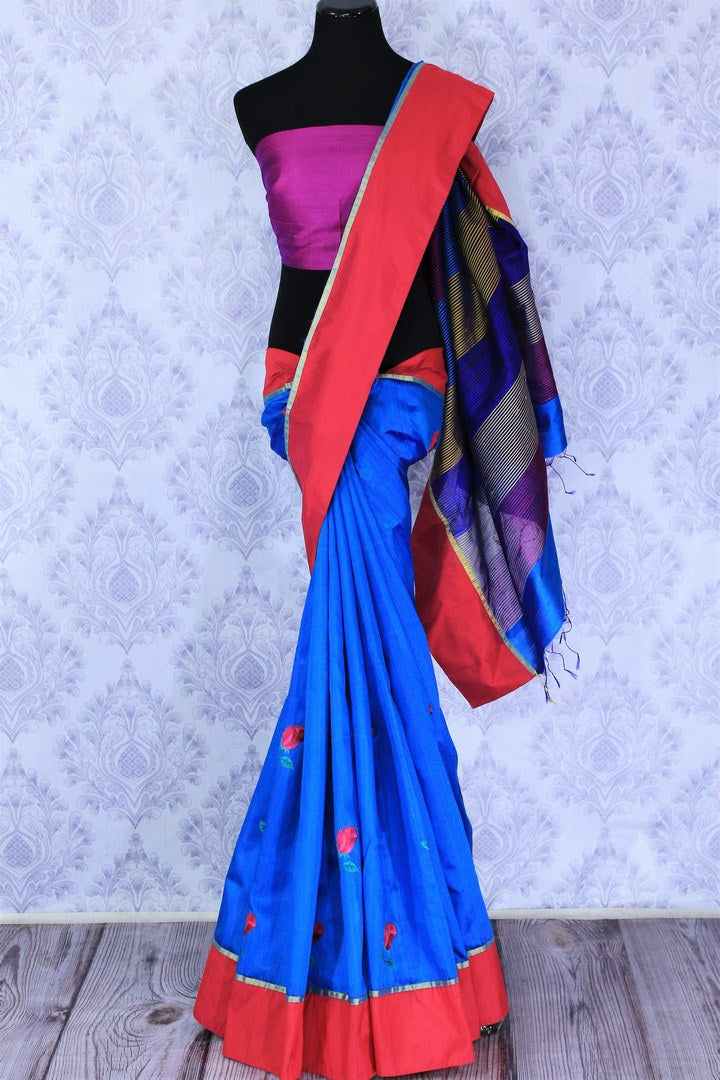 Buy bright blue silk sari online in USA with embroidered rose motifs . Make your Indian look special with beautiful Indian designer silk sarees available at Pure Elegance Indian clothing store in USA or shop online.-full view