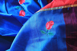 Buy bright blue silk sari online in USA with embroidered rose motifs . Make your Indian look special with beautiful Indian designer silk sarees available at Pure Elegance Indian clothing store in USA or shop online.-details