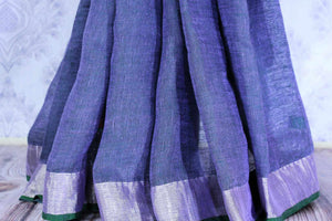 Elegant blue linen saree buy online in USA with embroidered saree blouse. Make your Indian look special with beautiful Indian handloom sarees, linen saris available at Pure Elegance Indian clothing store in USA or shop online.-pleats