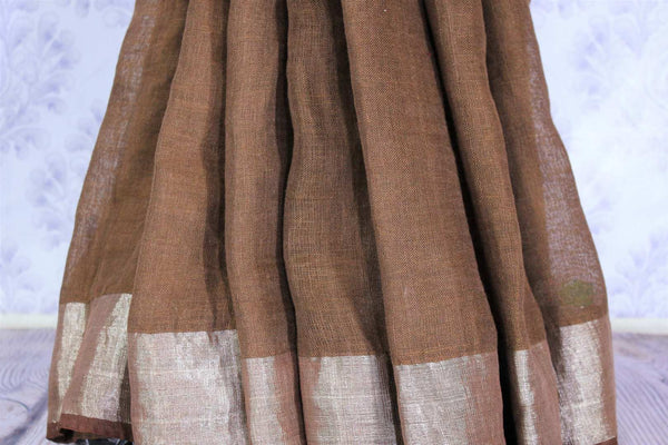 Alluring brown linen saree with embroidered saree blouse buy online in USA. Make your Indian look special with beautiful Indian handloom sarees, linen saris available at Pure Elegance Indian clothing store in USA or shop online.-pleats