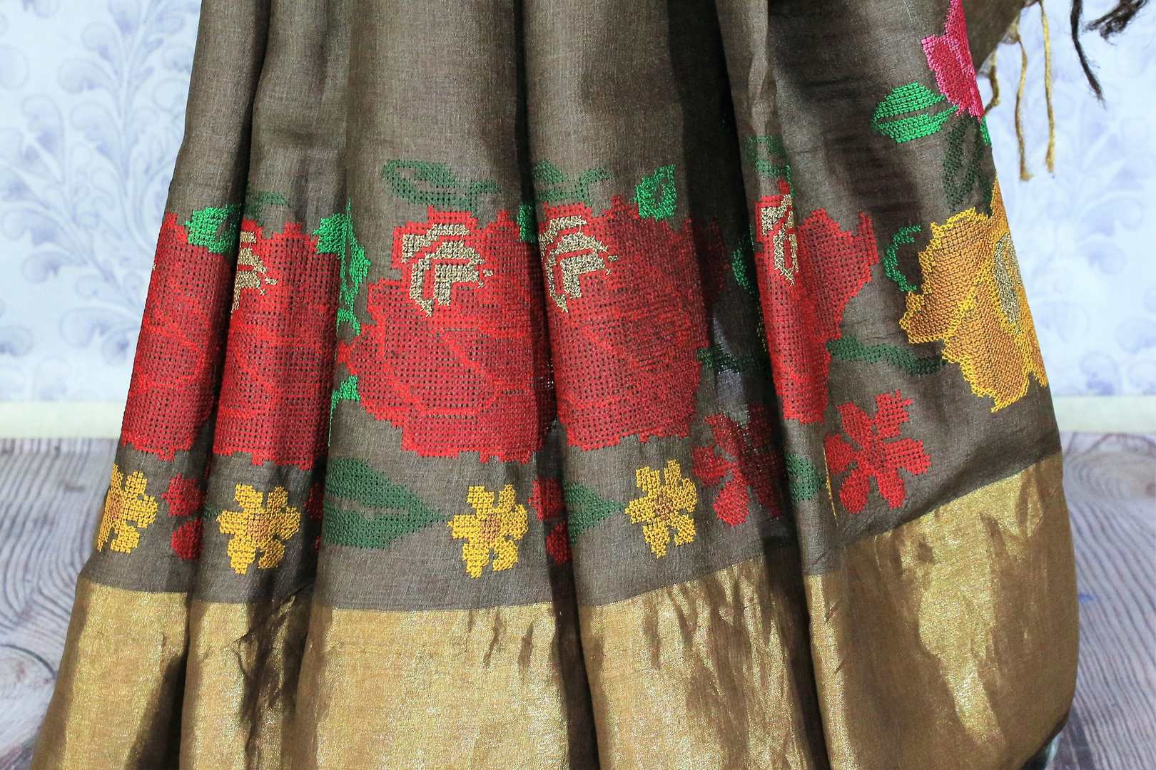 Buy brown color tussar silk saree online in USA with bright floral embroidery. Make a statement with your Indian saree look at special occasions with an exquisite collection of Indian designer sarees available at Pure Elegance clothing store or shop online.-pleats