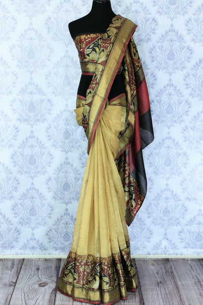 Buy elegant beige kota silk saree online in USA with printed border. Make a statement with your Indian saree look at special occasions with an exquisite collection of Indian designer sarees available at Pure Elegance clothing store or shop online.-full view