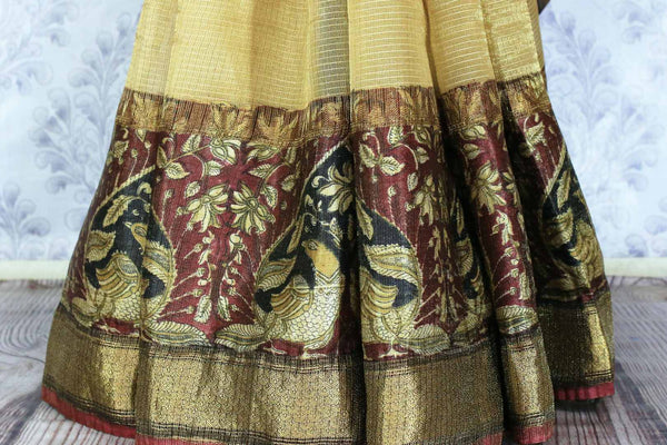 Buy elegant beige kota silk saree online in USA with printed border. Make a statement with your Indian saree look at special occasions with an exquisite collection of Indian designer sarees available at Pure Elegance clothing store or shop online.-pleats