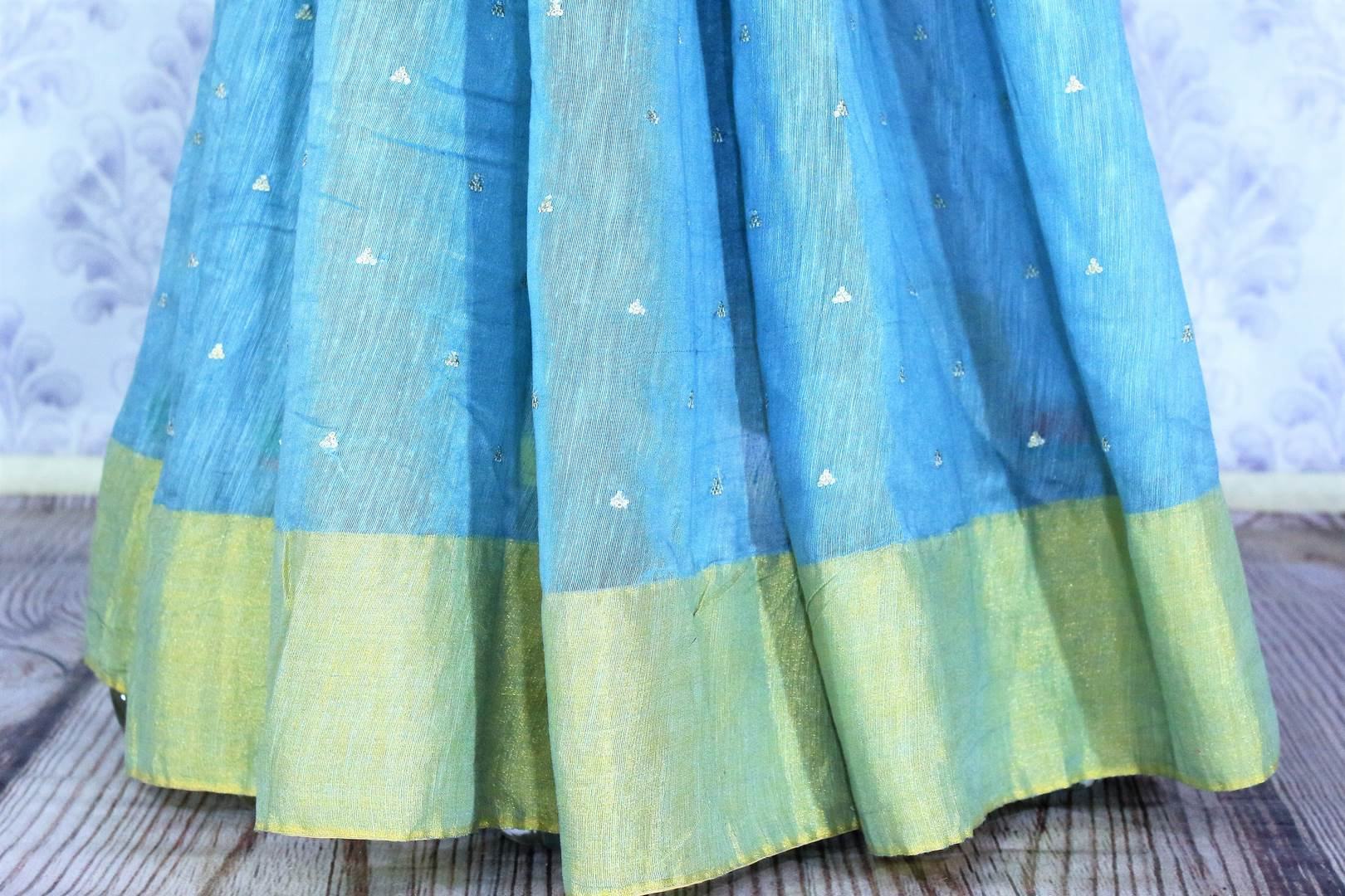 Buy online sky blue embroidered matka silk sari in USA with golden border. Make a statement with your Indian saree look at special occasions with an exquisite collection of Indian designer silk sarees available at Pure Elegance clothing store or shop online.-pleats