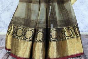Buy grey check organza saree online in USA with golden border. Make a statement with your Indian saree look at special occasions with an exquisite collection of Indian designer sarees available at Pure Elegance clothing store or shop online.-pleats