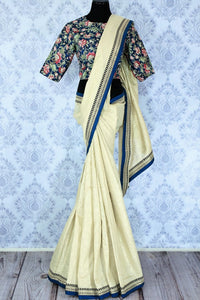 Shop cream tussar silk saree online in USA with a printed blouse. Bring a touch of tradition to your Indian look with an exquisite range Indian designer saris available at Pure Elegance Indian fashion store in USA or shop online.-full view