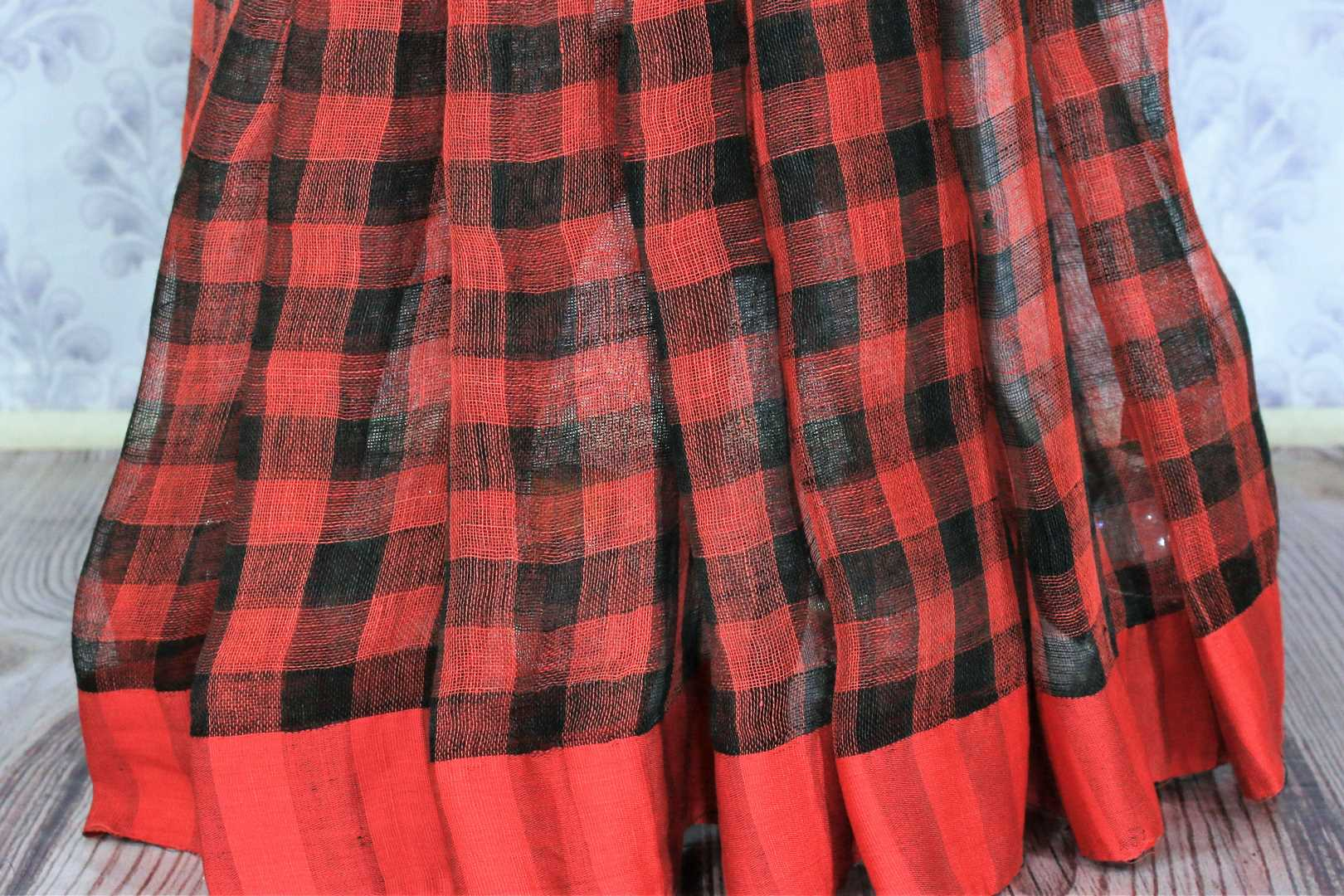 Shop red and black check linen saree online in USA with a printed blouse. Bring a touch of tradition to your Indian look with an exquisite range Indian handloom saris, pure linen sarees available at Pure Elegance Indian fashion store in USA or shop online.-pleats