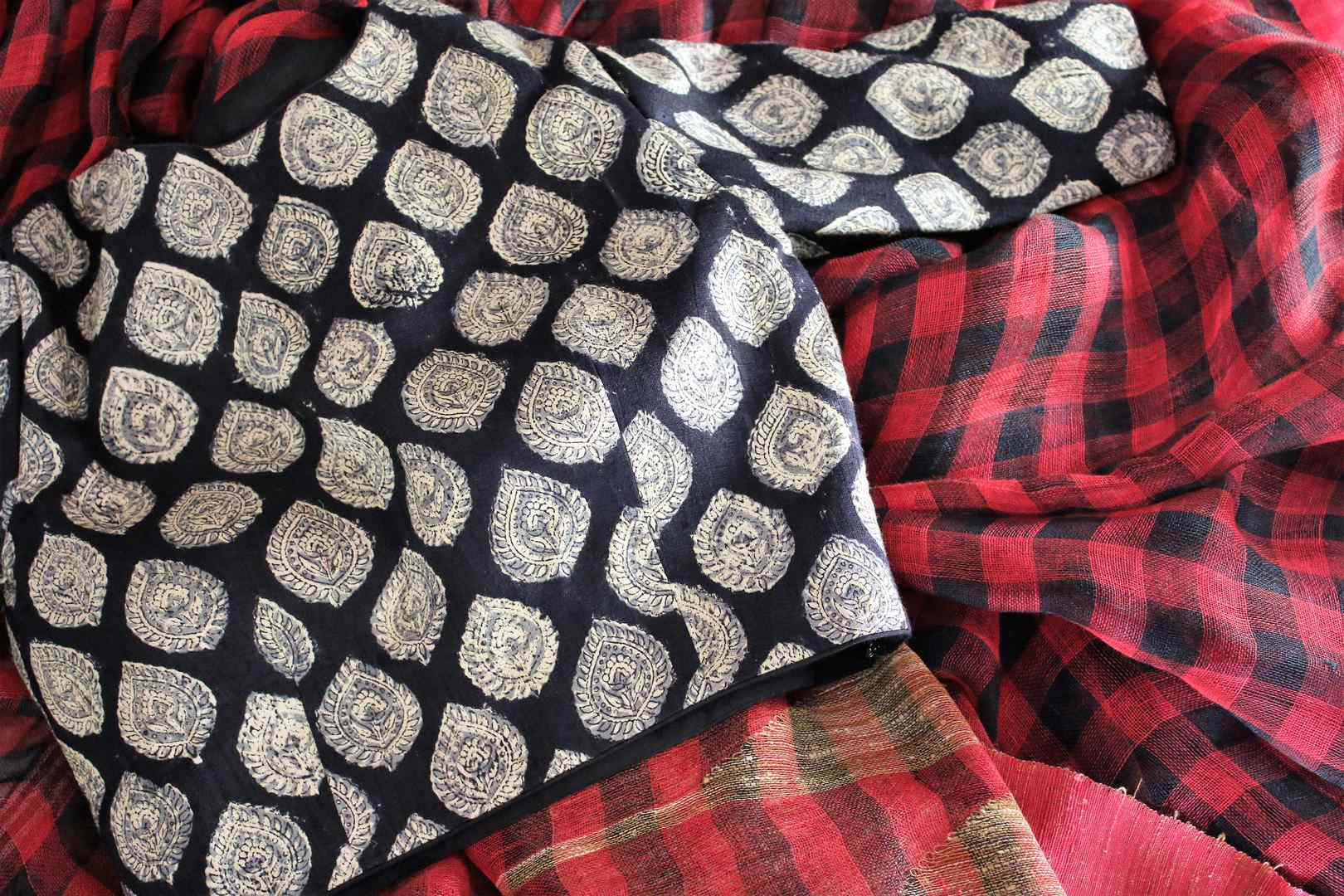 Shop red and black check linen saree online in USA with a printed blouse. Bring a touch of tradition to your Indian look with an exquisite range Indian handloom saris, pure linen sarees available at Pure Elegance Indian fashion store in USA or shop online.-details