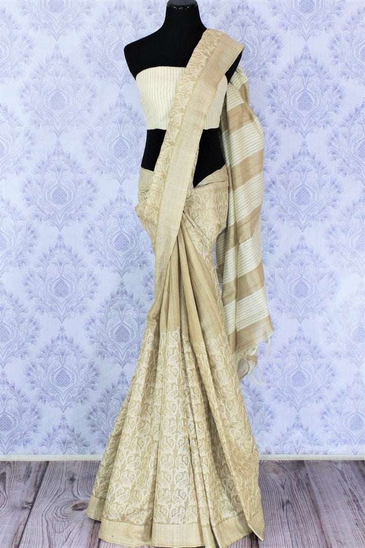 Shop beige embroidered tussar silk saree online in USA with striped pallu. Bring a touch of tradition to your Indian look with an exquisite range Indian handloom saris, pure silk sarees available at Pure Elegance Indian fashion store in USA or shop online.-full view