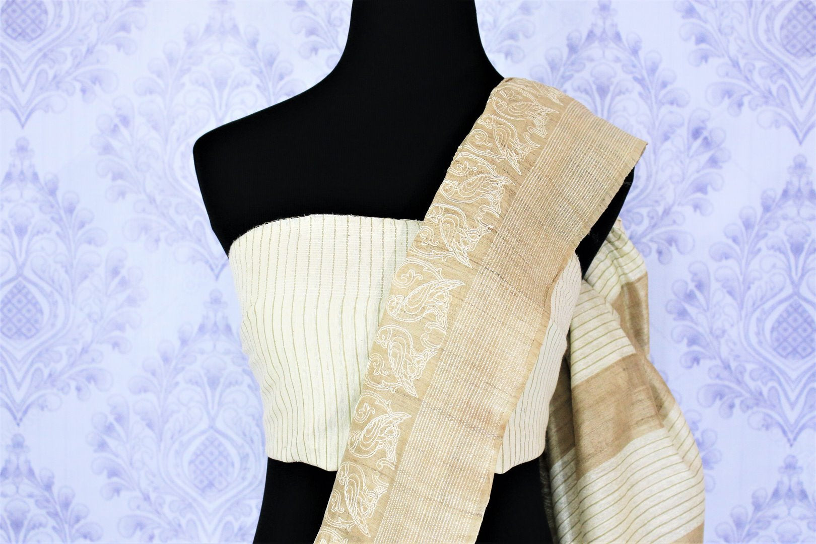 Shop beige embroidered tussar silk saree online in USA with striped pallu. Bring a touch of tradition to your Indian look with an exquisite range Indian handloom saris, pure silk sarees available at Pure Elegance Indian fashion store in USA or shop online.-blouse pallu