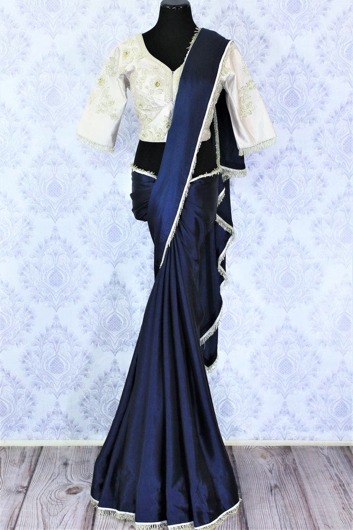 Shop navy blue crepe silk designer saree online in USA with embroidered blouse. Bring a touch of tradition to your Indian look with an exquisite range Indian designer sarees available at Pure Elegance Indian fashion store in USA or shop online.-full view