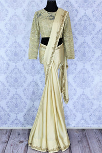 Shop beige crepe silk sari online in USA with embroidered net blouse. Bring a touch of tradition to your Indian look with an exquisite range Indian designer sarees, embroidered saris available at Pure Elegance Indian fashion store in USA or shop online.-full view