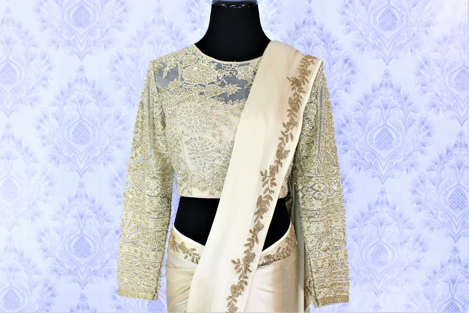 Shop beige crepe silk sari online in USA with embroidered net blouse. Bring a touch of tradition to your Indian look with an exquisite range Indian designer sarees, embroidered saris available at Pure Elegance Indian fashion store in USA or shop online.-blouse pallu