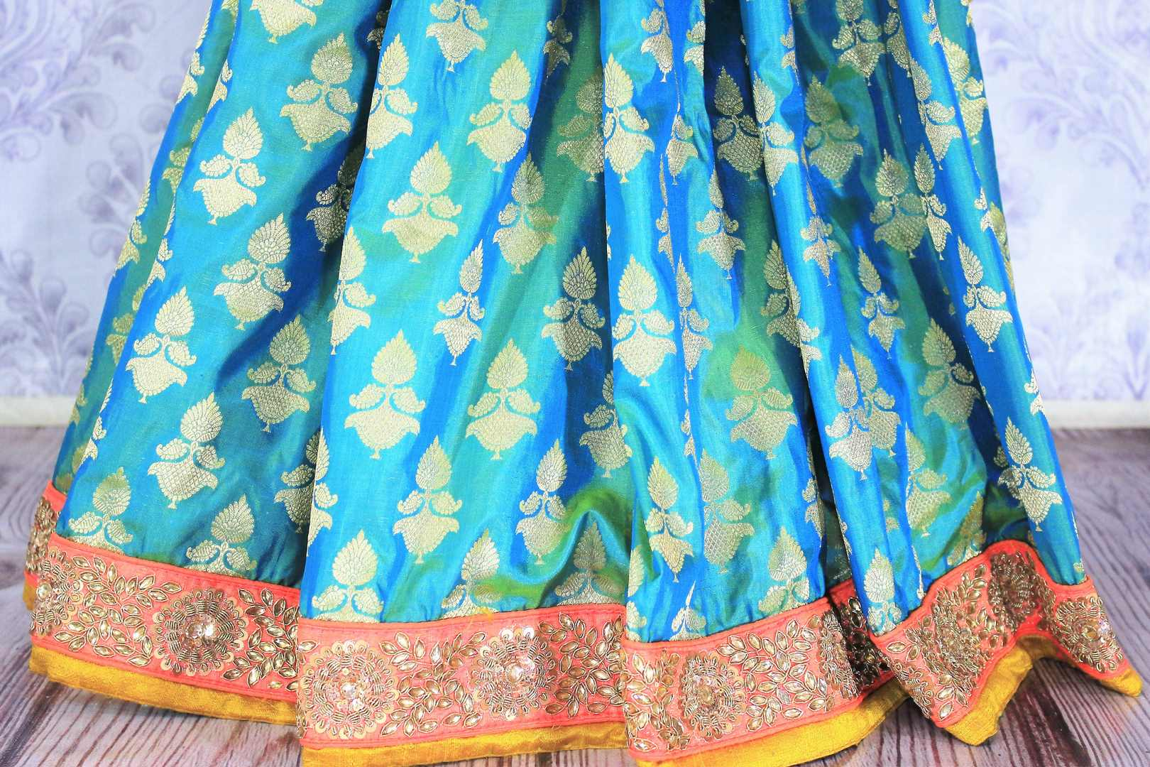 Shop greenish blue embroidered Banarasi silk sari online in USA with zari buta. Bring a touch of tradition to your Indian look with an exquisite range Indian designer silk saris, embroidered sarees available at Pure Elegance Indian fashion store in USA or shop online.-pleats