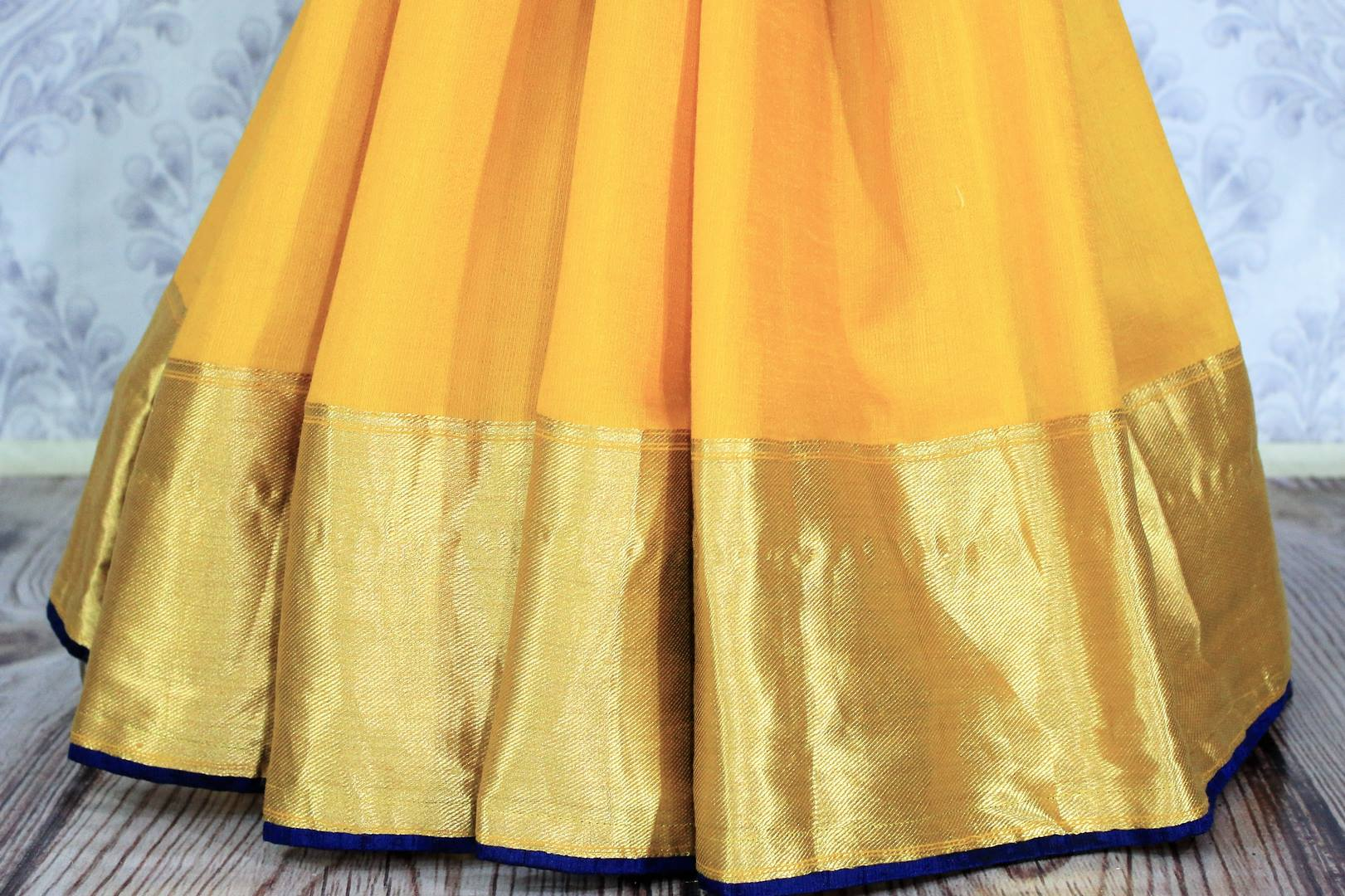 Buy yellow muga Banarasi saree online in USA with embroidered saree blouse. Bring a touch of tradition to your Indian look with an exquisite range of Indian designer silk saris, embroidered sarees available at Pure Elegance Indian fashion store in USA or shop online.-pleats