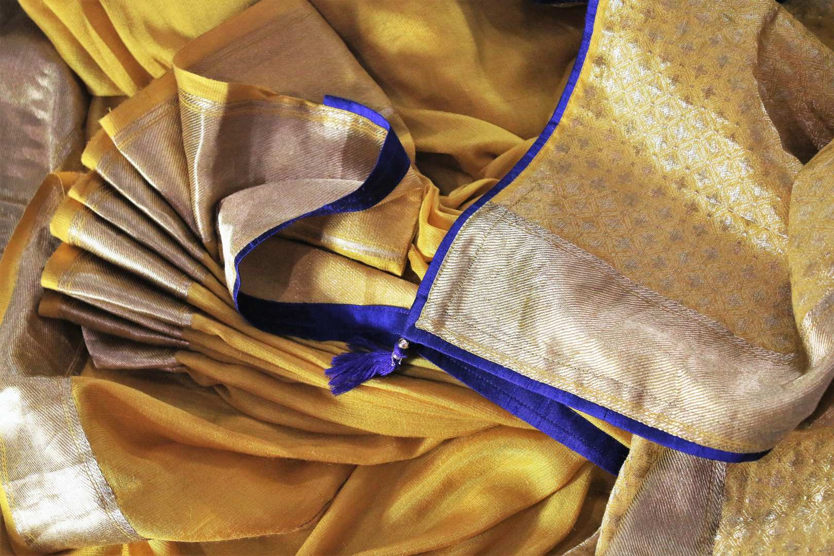 Buy yellow muga Banarasi saree online in USA with embroidered saree blouse. Bring a touch of tradition to your Indian look with an exquisite range of Indian designer silk saris, embroidered sarees available at Pure Elegance Indian fashion store in USA or shop online.-details