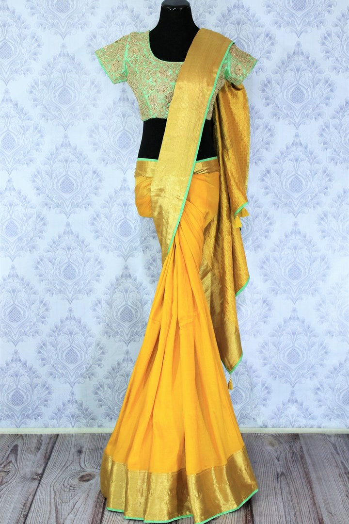 Shop yellow muga Banarasi saree online in USA with green embroidered saree blouse. Bring a touch of tradition to your Indian look with an exquisite range Indian designer silk saris, Banarasi sarees available at Pure Elegance Indian fashion store in USA or shop online.-full view