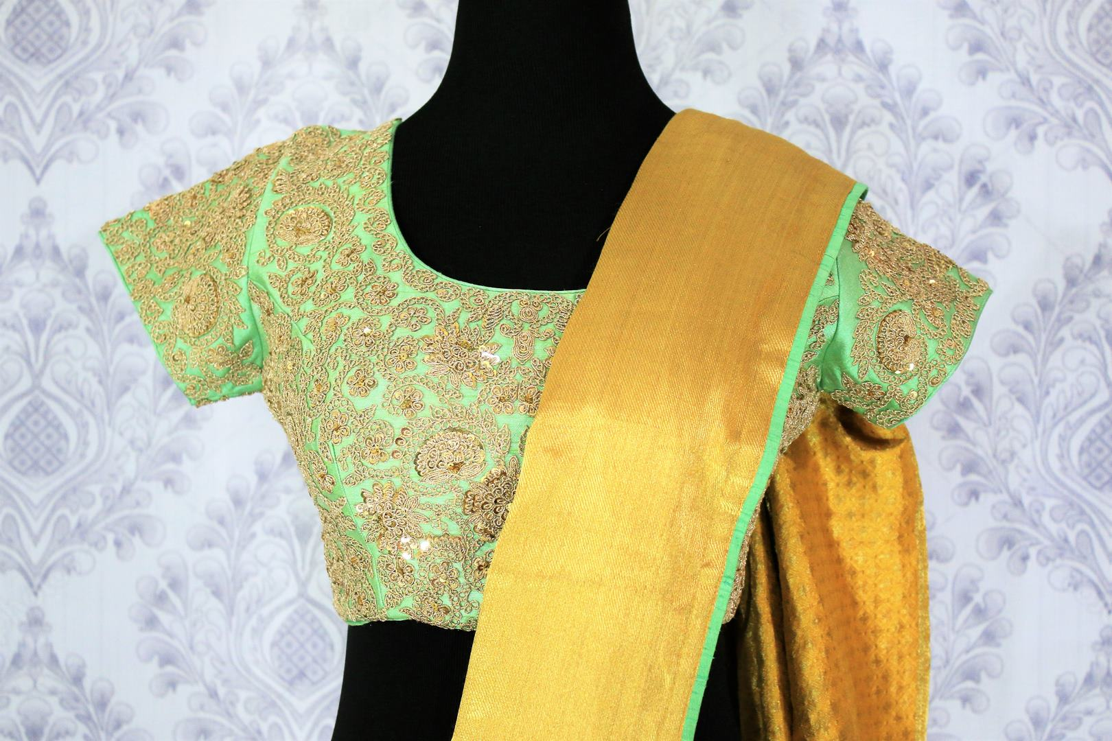 Shop yellow muga Banarasi saree online in USA with green embroidered saree blouse. Bring a touch of tradition to your Indian look with an exquisite range Indian designer silk saris, Banarasi sarees available at Pure Elegance Indian fashion store in USA or shop online.-blouse pallu