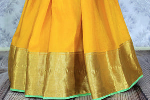 Shop yellow muga Banarasi saree online in USA with green embroidered saree blouse. Bring a touch of tradition to your Indian look with an exquisite range Indian designer silk saris, Banarasi sarees available at Pure Elegance Indian fashion store in USA or shop online.-pleats