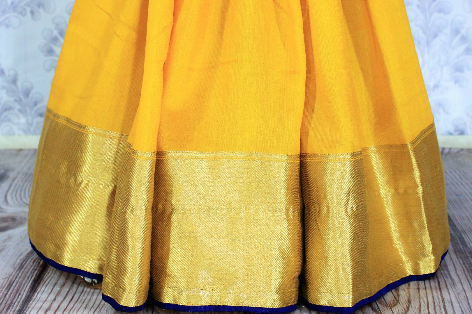 Buy online yellow muga Banarasi saree in USA with black embroidered saree blouse. Bring a touch of tradition to your Indian look with an exquisite range Indian designer silk saris, Banarasi sarees available at Pure Elegance Indian fashion store in USA or shop online.-pleats