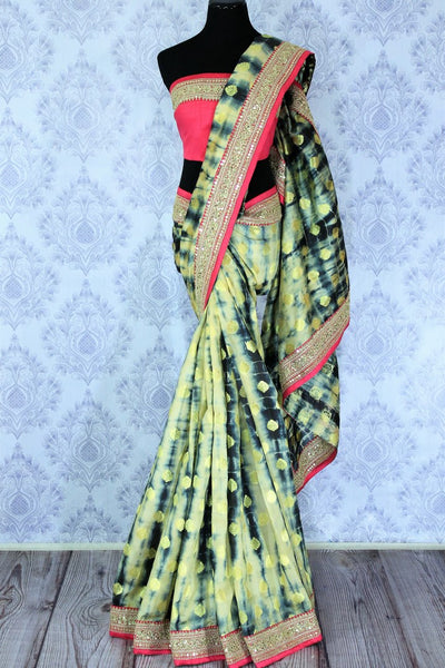 Buy blue and cream shiburi print muga Banarasi saree online in USA. It is a beautiful blend of shiburi print, zari buta and pink embroidered border. Make your Indian clothing collection exquisite with beautiful Indian designer sarees, Banarasi sarees available at Pure Elegance clothing store in USA or shop online.-full view