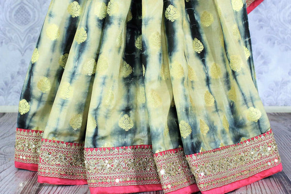 Buy blue and cream shiburi print muga Banarasi saree online in USA. It is a beautiful blend of shiburi print, zari buta and pink embroidered border. Make your Indian clothing collection exquisite with beautiful Indian designer sarees, Banarasi sarees available at Pure Elegance clothing store in USA or shop online.-pleats