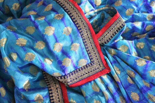 Buy blue embroidered Banarasi silk saree with zari buta online in USA. Make your Indian saree collection exquisite with beautiful Indian designer sarees, Banarasi sarees available at Pure Elegance clothing store in USA or shop online.-details