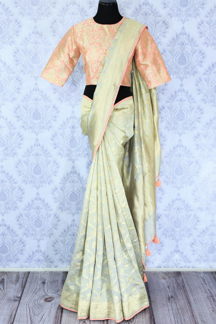 Buy pastel green Muga Banarasi saree with saree blouse online in USA. Make your Indian saree collection exquisite with beautiful Indian designer sarees, Banarasi sarees available at Pure Elegance clothing store in USA or shop online.-full view
