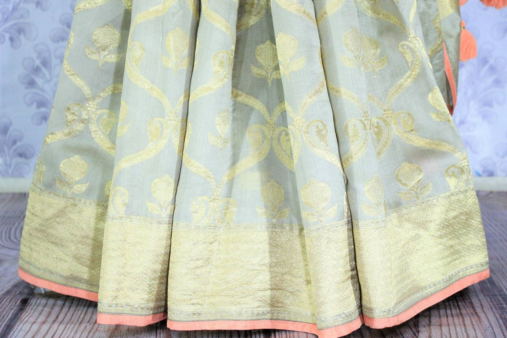 Buy pastel green Muga Banarasi saree with saree blouse online in USA. Make your Indian saree collection exquisite with beautiful Indian designer sarees, Banarasi sarees available at Pure Elegance clothing store in USA or shop online.-pleats