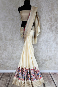 Buy elegant off white tussar silk embroidered saree online in USA. The alluring drape is a perfect choice for festive and special occasions. For more such traditional Indian designer sarees in USA, shop from the exquisite collection at Pure Elegance Indian clothing store.-full view