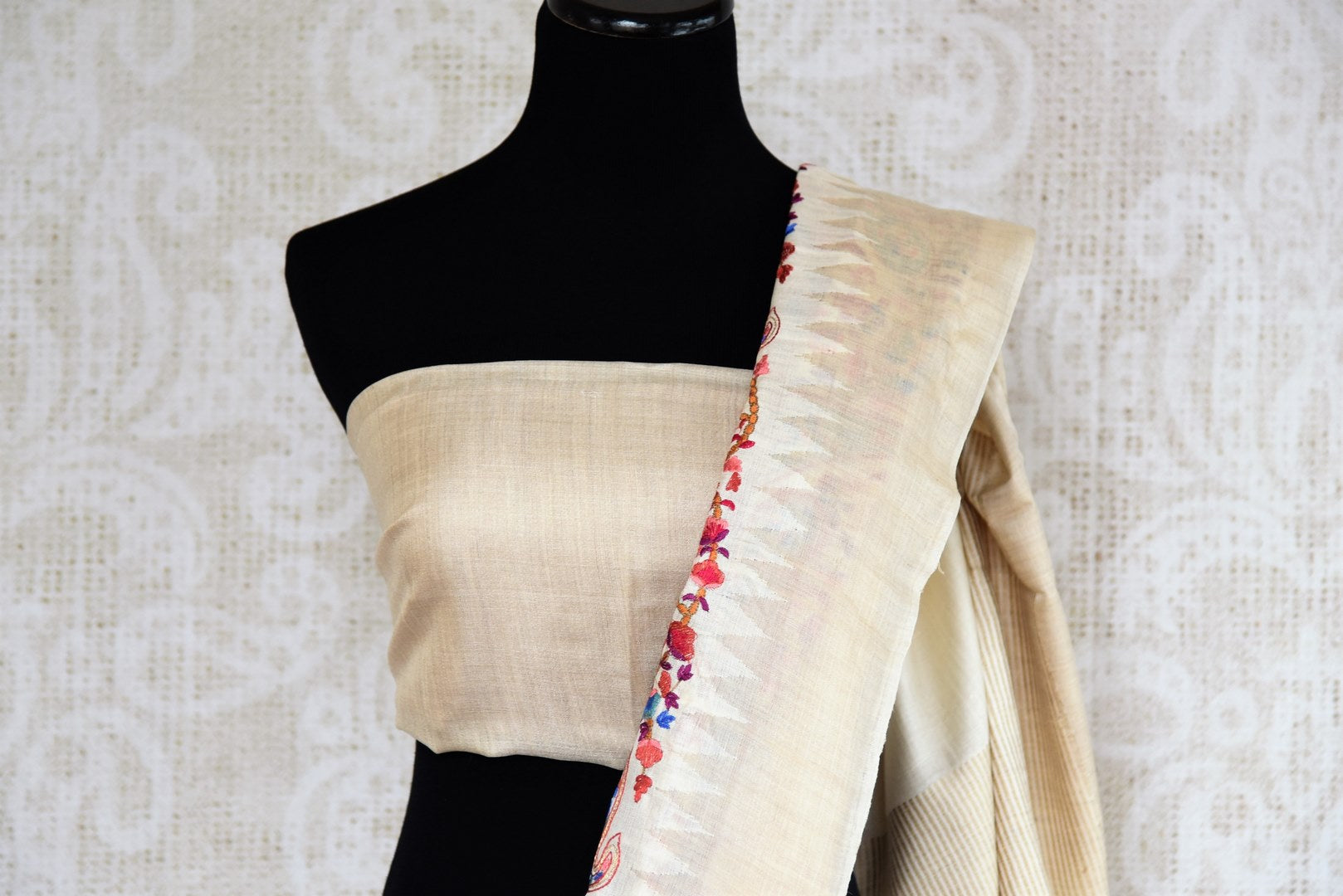 Buy elegant off white tussar silk embroidered saree online in USA. The alluring drape is a perfect choice for festive and special occasions. For more such traditional Indian designer sarees in USA, shop from the exquisite collection at Pure Elegance Indian clothing store.-blouse pallu