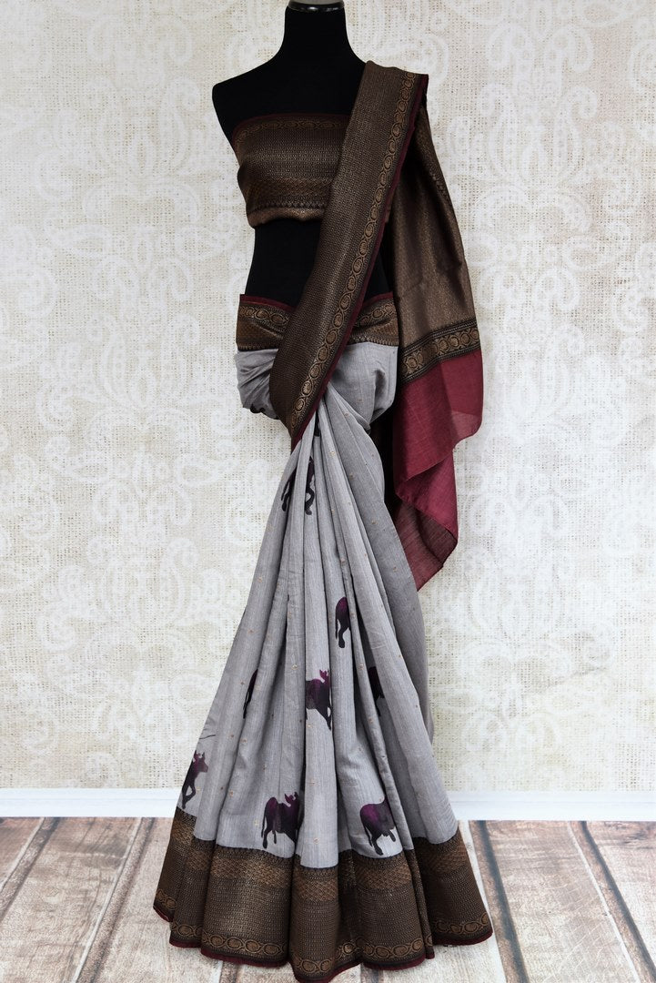 Buy grey tussar silk saree online in USA with Banarasi zari border. The alluring drape is a perfect choice for festive and special occasions. For more such Indian designer silk sarees in USA, shop from the exquisite collection at Pure Elegance Indian clothing store.-full view
