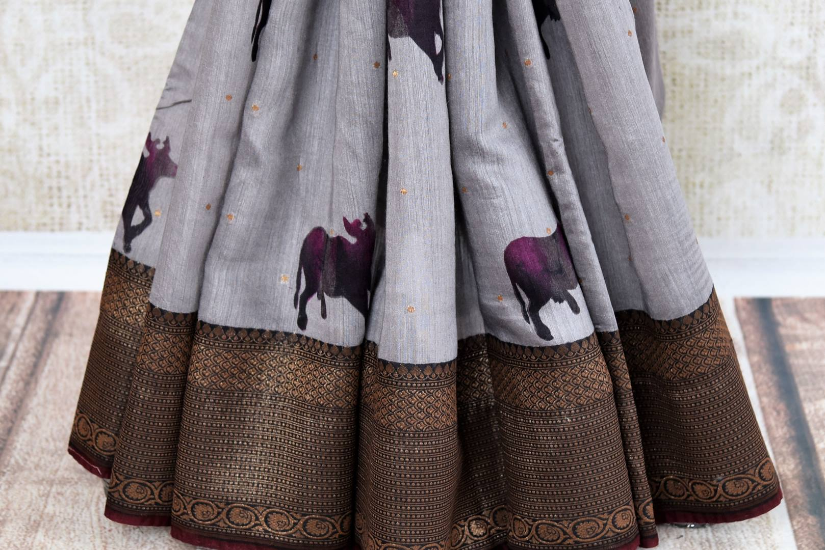 Buy grey tussar silk saree online in USA with Banarasi zari border. The alluring drape is a perfect choice for festive and special occasions. For more such Indian designer silk sarees in USA, shop from the exquisite collection at Pure Elegance Indian clothing store.-pleats
