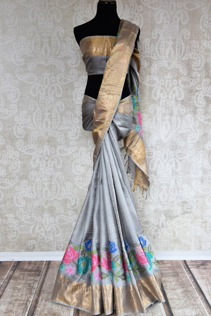 Buy alluring grey tussar sari online in USA with cross stitch embroidery. The saree is an elegant drape for parties and special occasions. For Indian women in USA, Pure Elegance brings a range of stunning Indian sarees online and at their exclusive fashion store in USA.-full view