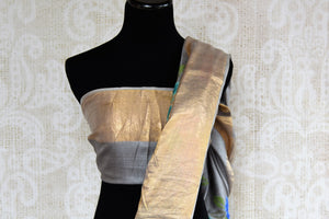 Buy alluring grey tussar sari online in USA with cross stitch embroidery. The saree is an elegant drape for parties and special occasions. For Indian women in USA, Pure Elegance brings a range of stunning Indian sarees online and at their exclusive fashion store in USA.-blouse pallu