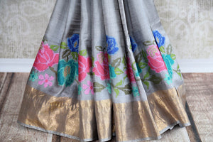 Buy alluring grey tussar sari online in USA with cross stitch embroidery. The saree is an elegant drape for parties and special occasions. For Indian women in USA, Pure Elegance brings a range of stunning Indian sarees online and at their exclusive fashion store in USA.-pleats