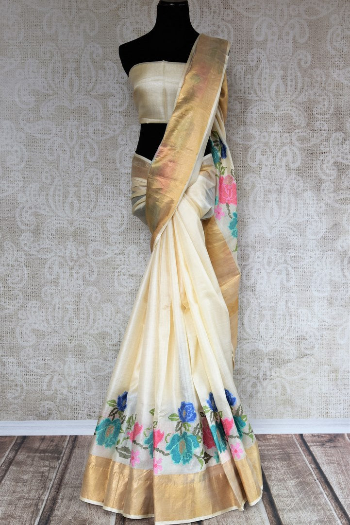 Buy elegant off white tussar saree online in USA with cross stitch embroidery. The saree is an alluring drape for parties and special occasions. For Indian women in USA, Pure Elegance brings a range of stunning Indian handloom sarees online and at their exclusive fashion store in USA.-full view