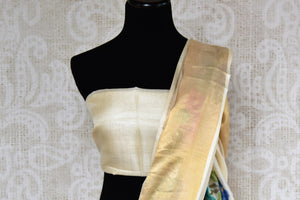 Buy elegant off white tussar saree online in USA with cross stitch embroidery. The saree is an alluring drape for parties and special occasions. For Indian women in USA, Pure Elegance brings a range of stunning Indian handloom sarees online and at their exclusive fashion store in USA.-blouse pallu