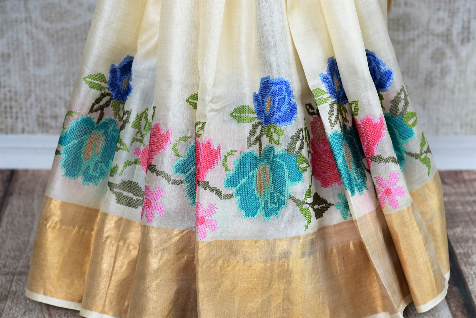 Buy elegant off white tussar saree online in USA with cross stitch embroidery. The saree is an alluring drape for parties and special occasions. For Indian women in USA, Pure Elegance brings a range of stunning Indian handloom sarees online and at their exclusive fashion store in USA.-pleats