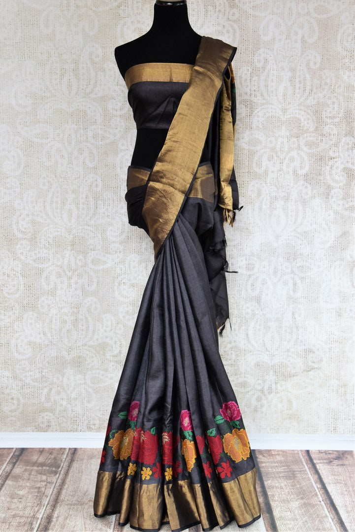 Buy black tussar silk saree online in USA with bright floral embroidery. The classic drape is a perfect choice for festive and special occasions. For more such Indian designer sarees in USA, shop from the exquisite collection at Pure Elegance Indian clothing store.-full view