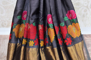 Buy black tussar silk saree online in USA with bright floral embroidery. The classic drape is a perfect choice for festive and special occasions. For more such Indian designer sarees in USA, shop from the exquisite collection at Pure Elegance Indian clothing store.-pleats