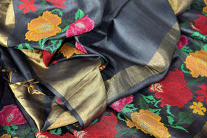 Buy black tussar silk saree online in USA with bright floral embroidery. The classic drape is a perfect choice for festive and special occasions. For more such Indian designer sarees in USA, shop from the exquisite collection at Pure Elegance Indian clothing store.-details