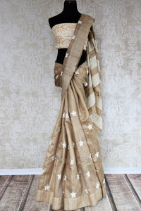 Buy elegant brown embroidered tussar saree online in USA. The saree is a classic choice for parties and special occasions. For Indian women in USA, Pure Elegance brings a range of stunning Indian handloom sarees online and at their exclusive fashion store in USA.-full view