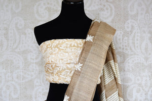 Buy elegant brown embroidered tussar saree online in USA. The saree is a classic choice for parties and special occasions. For Indian women in USA, Pure Elegance brings a range of stunning Indian handloom sarees online and at their exclusive fashion store in USA.-blouse pallu