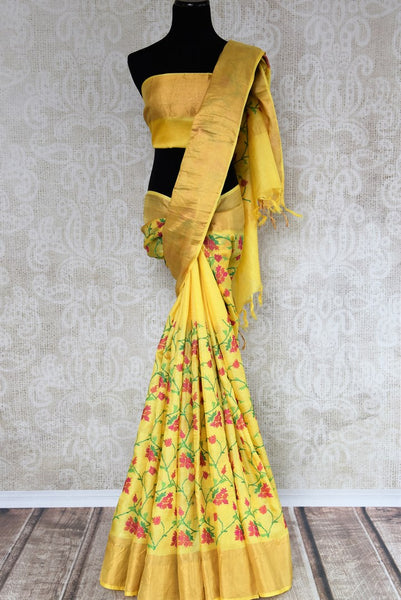 Buy yellow tussar silk saree online in USA with resham floral embroidery. The classic drape is a perfect choice for festive and special occasions. For more such Indian designer sarees in USA, shop from the exquisite collection at Pure Elegance Indian clothing store.-full view