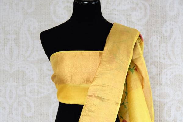 Buy yellow tussar silk saree online in USA with resham floral embroidery. The classic drape is a perfect choice for festive and special occasions. For more such Indian designer sarees in USA, shop from the exquisite collection at Pure Elegance Indian clothing store.-blouse pallu